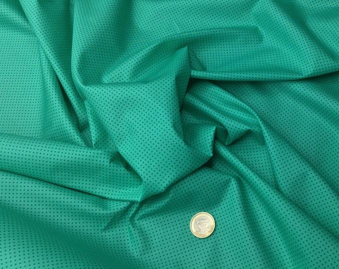 High quality cotton poplin. Teal polka dots on green nr35