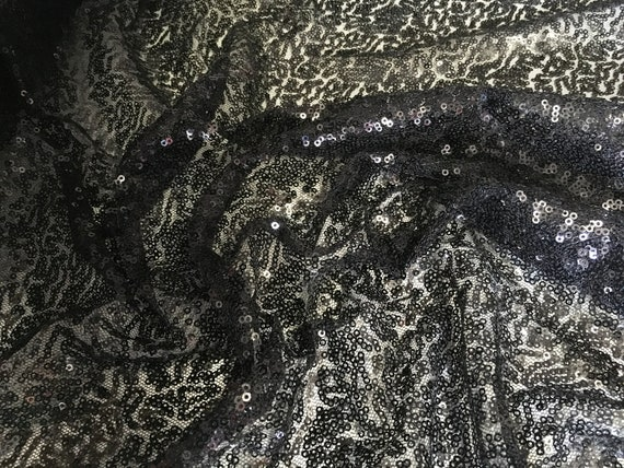 Light tulle dress fabric embroidered with small sequins, black