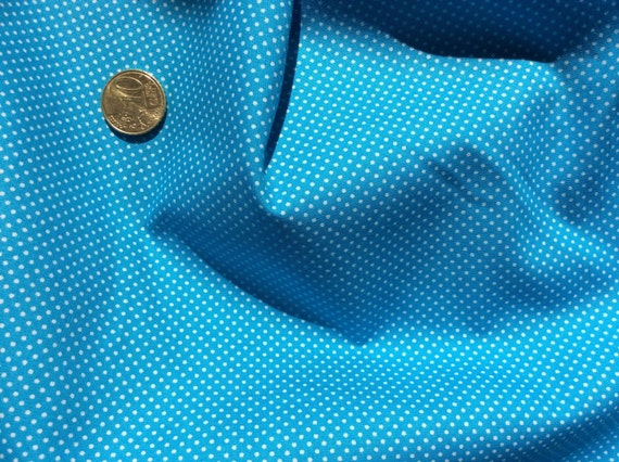 High quality cotton poplin dyed in Japan with 2mm polka dots mid turquoise