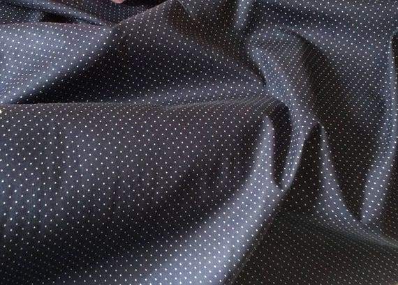 Japanese printed cotton poplin sold per 25cm, 1mm white polka dots on navy