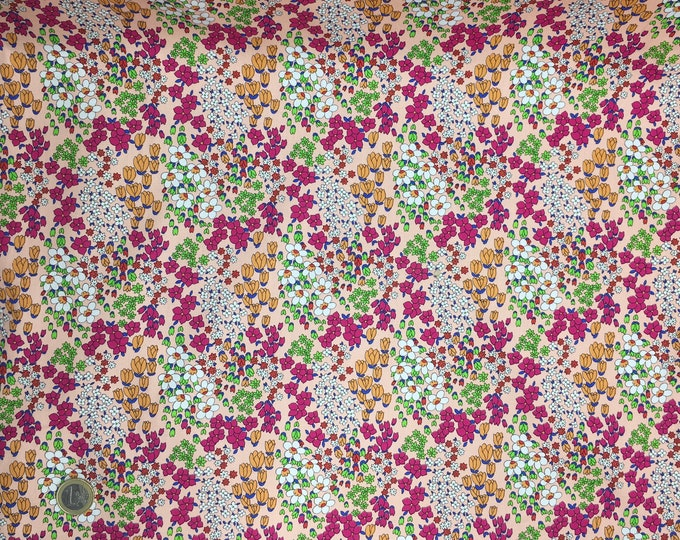 High quality cotton poplin dyed in Japan with floral on peach