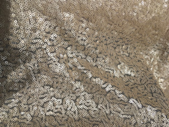 Light tulle dress fabric embroidered with small sequins, mat nude or champagne