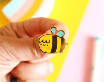 Honey The Bee Hard Enamel Pin, Gold Nickel Plating with blue glitters, 25mm wide enamel pin.