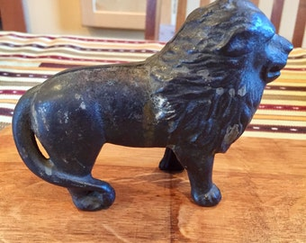 Vintage cast iron lion penny bank, tail right