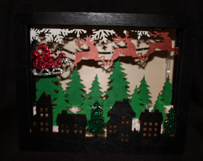 Hand painted Scenic Christmas LED Shadow Box with houses, trees and Santa's sleigh with reindeer