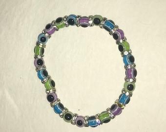 Multi-color evil eye bead stretch bracelet -blue, green, purple