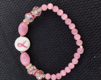 Handmade Breast cancer awareness bracelet pink ribbons and beads with silver spacers