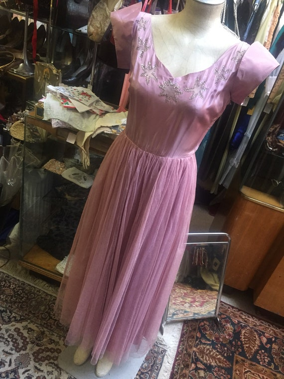Lovely lavender formal dress of tge 1940s featurin