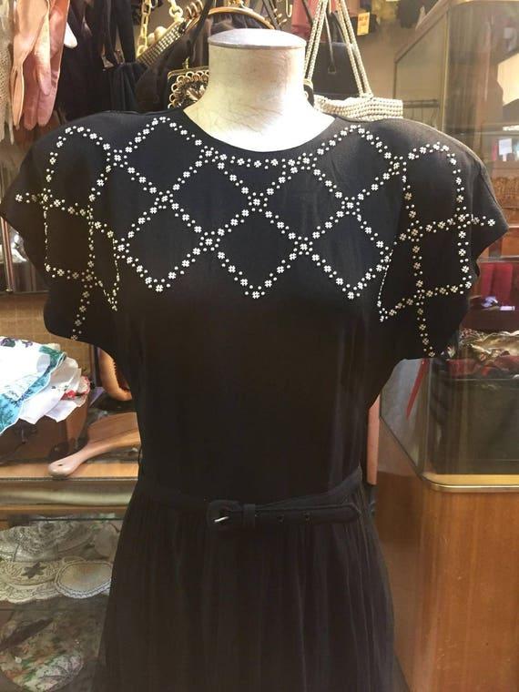 Wonderful black 1940s dress featuring white studs!
