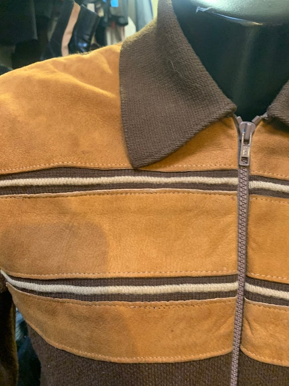 Snazzy sweater of the 1970s with suede chest detai