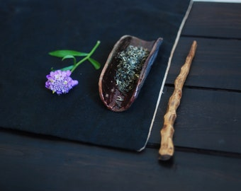 Ceramic chahe with wooden stick for acquitance with tea