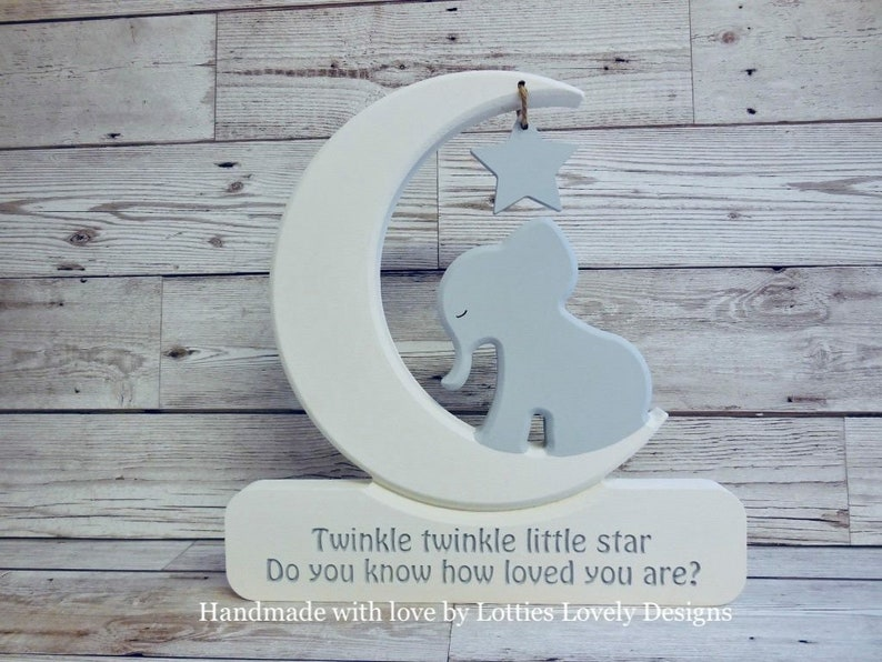 Elephant in a moon plaque. Star Gazing / Moon & hanging star / image 0