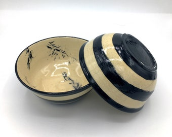 Handmade wheel thrown stoneware bowls with printed feathers and stripes using black slip