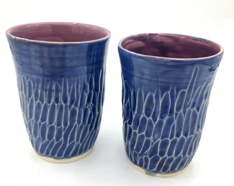 Handmade wheel thrown stoneware tumblers with carved texture in blue and mauve