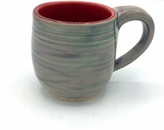 Wheel thrown stoneware mugs with mauve inside and purple green outside
