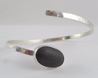 PEBBLE Sterling silver cuff bracelet with a bezel set stone.