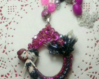 Two-headed creepy mermaid necklace, Evee and Evol. Made on a cameo base in handmade resin.