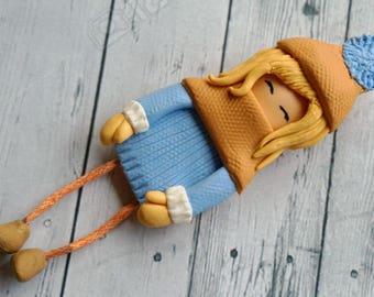 Girl brooch made of polymer clay