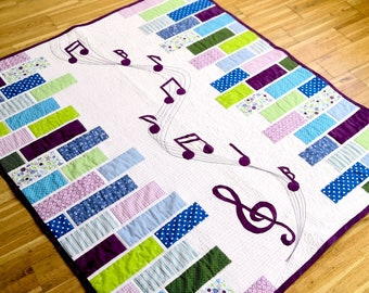 Sound of Music - a modern applique quilt pattern for Music lovers. With Music key and note applique. From a baby to a king size quilt.