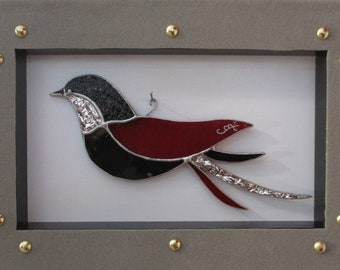 """Red, black and silver """"the courtesan"""" bird in stained glass, in velvet frame"""