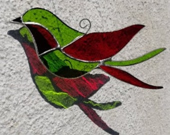 The Enchanter, a bird in stained glass with shimmering colors, suncatcher,  art nouveau style