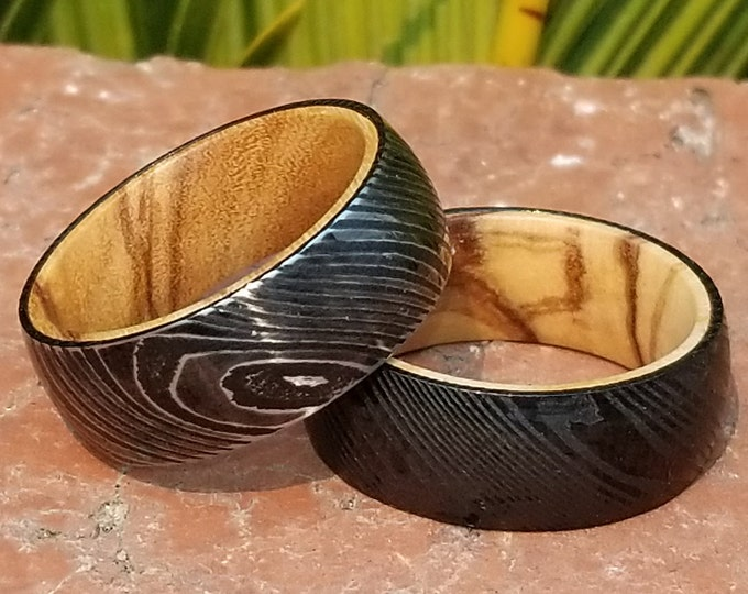 REG 499.95 -Genuine Damascus & Premium Quality Bethlehem /Holy Land /Figured Olive Wood Innerband Ring in your choice of Stain and Finish!