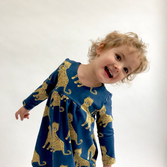 "Eddie & Bee organic cotton long sleeved dress in Navy or Coral ""Happy Leopards"" print."