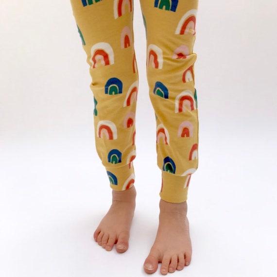 "Eddie & Bee organic cotton leggings in mustard ""Over the Rainbow "" print."