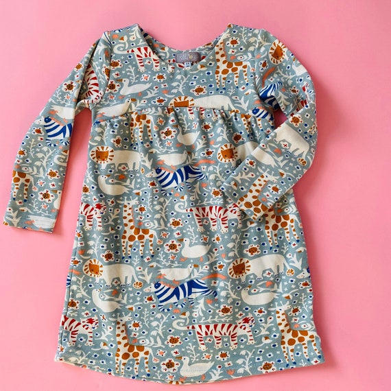 "Eddie & Bee organic cotton long sleeved dress in Mineral ""Animal Party "" print."