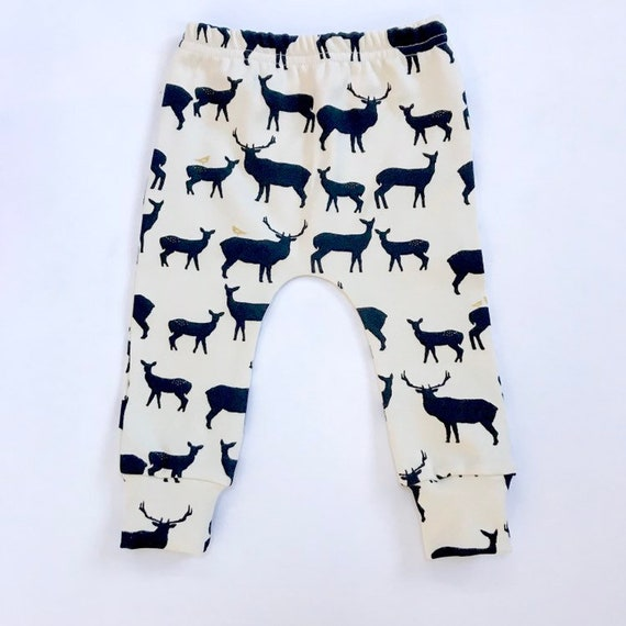 "Eddie & Bee organic cotton leggings in Cream/ Black/ Metalic Gold ""woodland Deer"" print."