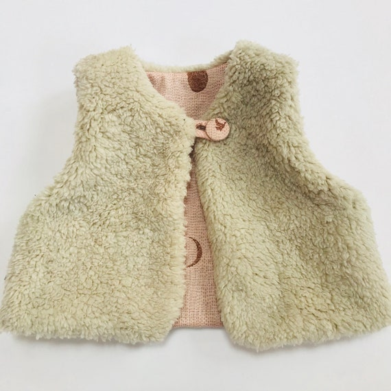 "Reversible fleecy gilet lined with Rose pink ""Moon and Stars"" japanese cotton."