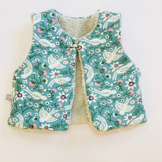 "Reversible fleecy gilet lined with printed organic cotton jersey in Mineral ""Tweet tweet"" print"