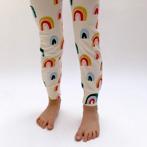 "Eddie & Bee organic cotton leggings in cream ""Over the Rainbow "" print."