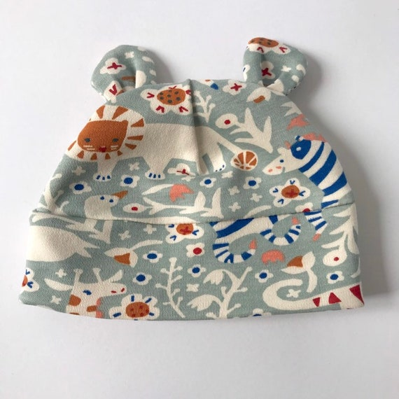 "Eddie & Bee organic cotton Baby hat with ears  in Mineral "" Animal Party "" print."