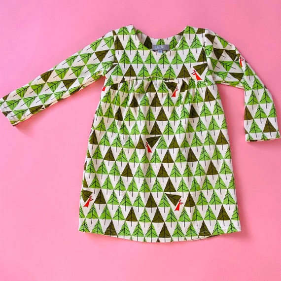 "Eddie & Bee organic cotton long sleeved dress in Christmas ""Pick the perfect tree "" print."
