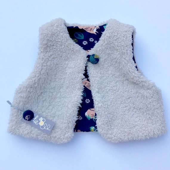 "Reversible fleecy gilet lined with printed organic cotton jersey in dusk ""bunnies"" print"