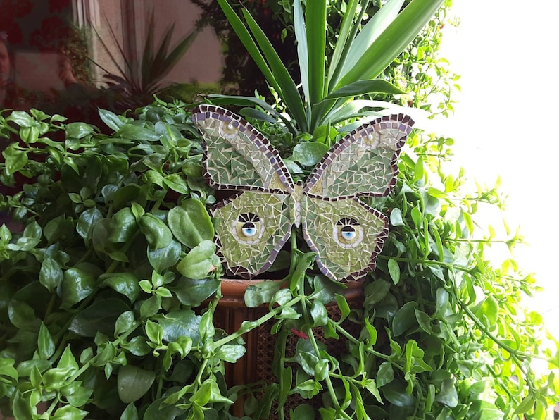 Wall hanging in green and purple.Springtime. Lunamoth winged butterfly mosaic