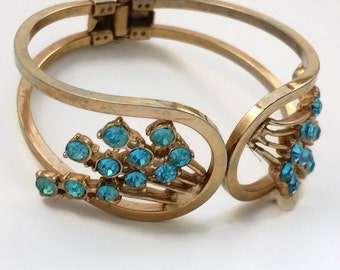 Beautiful 50,s Goldtone and Teal Rhinestone Spray Hinged Cuff Bracelet