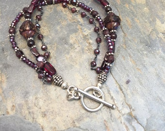 Garnet, czech and crystal beads sterling silver Bracelet.