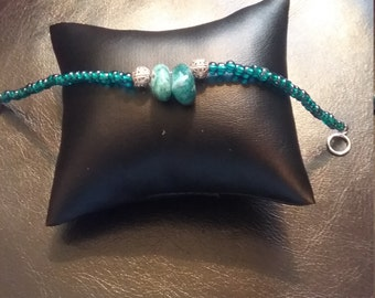 Glass  and turquoise beacelet now on sale.  Was 12.95 now 11.95