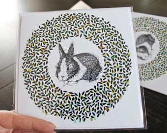 Greeting card with envelope. A greeting. Rabbit and circle pattern. Black, white, green, turquoise and orange. This Easter. 5.5 x 5.5 inches.