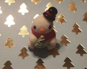 Snowman Baby Holding a Christmas Tree Cookie