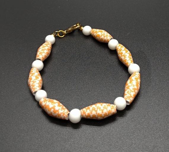 B-1619 Orange and white paper bead bracelet.