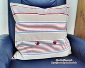 Square pillow with red tr...