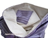 Purple cloth bag with ins...