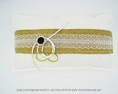 White ring pillow lace on...
