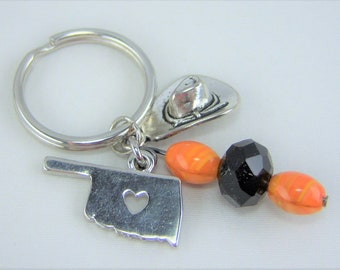 K214 - Orange and Black Glass Beads with Oklahoma and Cowboy Hat Charm Key Chain