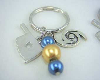 K217 - Blue and Gold Glass Pearl Bead with Oklahoma and Hurricane Charm Key Chain