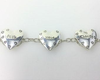 B528 - Faith Hope Charity Silver Heart Bracelet