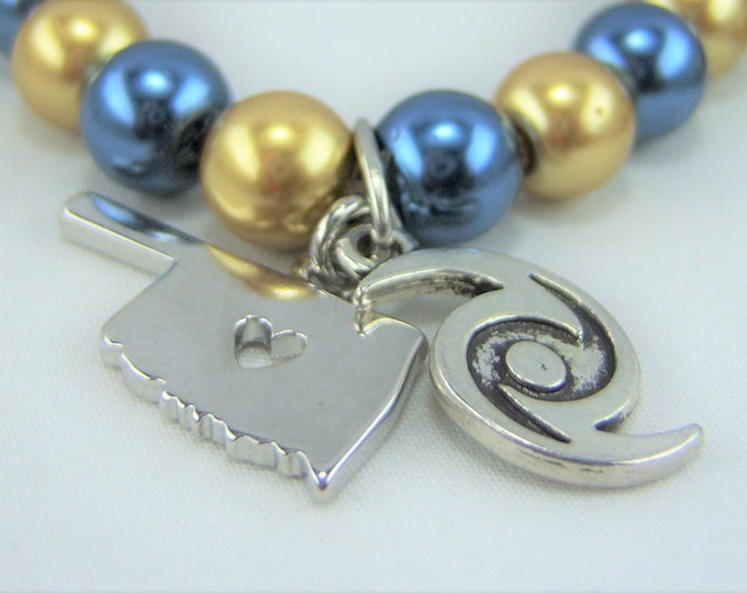 B295 - Blue and Gold Glass Pearls with Oklahoma and Hurricane Charm Bracelet